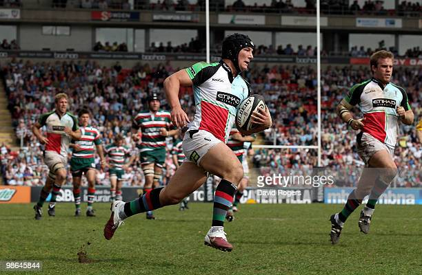 George Lowe of Harlequins races clear to score a try during the Guinness Premiership match between Leicester Tigers and Harlequins at Welford Road on...