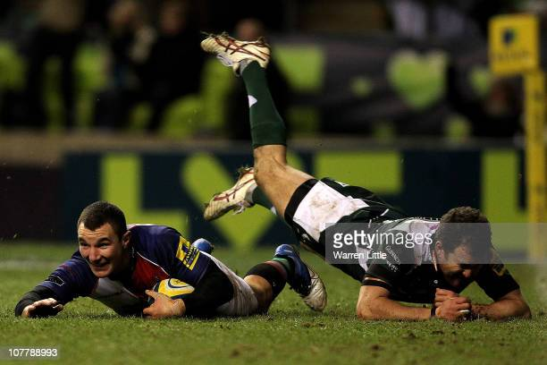 George Lowe of Harlequins scores a try during the AVIVA Premiership match between Harelquins and London Irish at Twickenham Stadium on December 27...