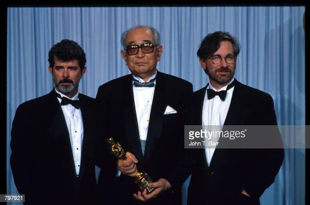 George Lucas Akira Kurosawa and Steven Spielberg stand backstage during the 62nd Academy Awards ceremony March 26 1990 in Los Angeles CA Kurosawa...