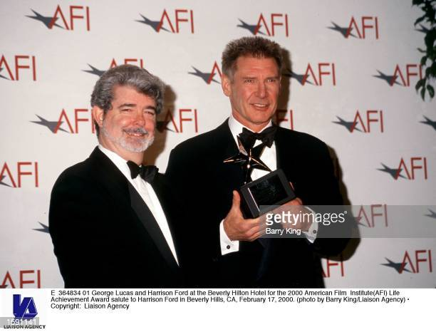 George Lucas and Harrison Ford at the Beverly Hilton Hotel for the 2000 American Film Institute Life Achievement Award salute to Harrison Ford in...