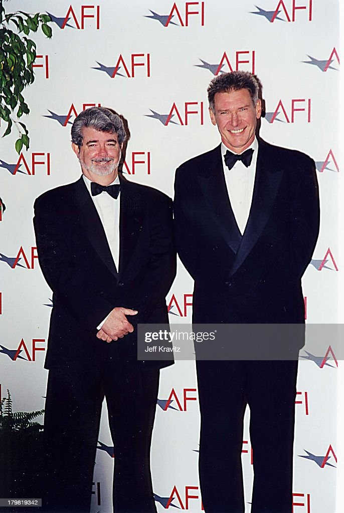 George Lucas & Harrison Ford during American Film Institute Honors Harrison Ford with 2000 Lifetime Achievement Award at Beverly Hilton Hotel in Beverly Hills, California, United States.