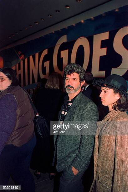 George Lucas with a young lady in a hat circa 1990 New York