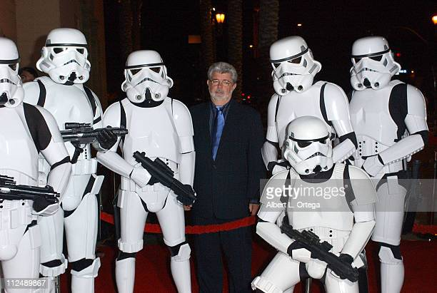 George Lucas with Stormtroopers of the 501st during The Jules Verne Adventure Film Festival and Expositions - Arrivals at The Shrine Auditorium in...