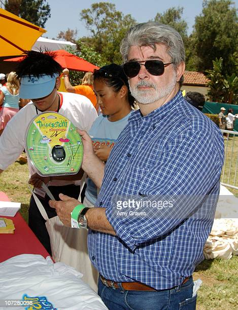 George Lucas with Tamagotchi Connection Virtual Pet
