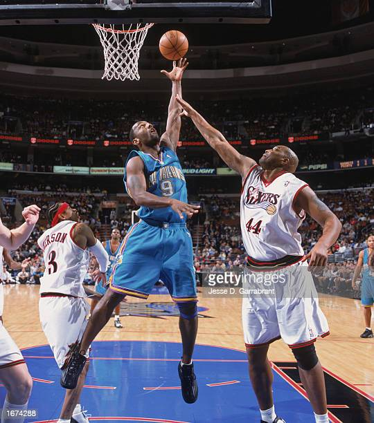 George Lynch of the New Orleans Hornets puts a shot up over Derrick Coleman of the Philadelphia 76ers at the First Union Center on November 25 2002...