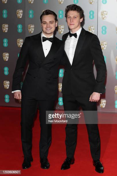 George MacKay and Dean-Charles Chapman attend the EE British Academy Film Awards 2020 at Royal Albert Hall on February 02, 2020 in London, England.