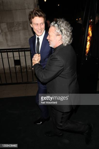 George MacKay and Dexter Fletcher arrive at the Charles Finch & CHANEL Pre-BAFTA Party at 5 Hertford Street on February 1, 2020 in London, England.