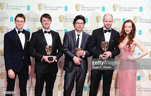 George MacKay and Olivia Grant pose with Michael Lennox, Ronan Blaney and Brian J. Falconer, winners of the Best Short Film award for 'Boogaloo and...