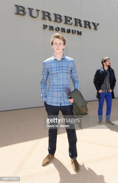 George MacKay arrives at Burberry Prorsum SS15 during London Collections Men at Kensington Gardens on June 17 2014 in London England