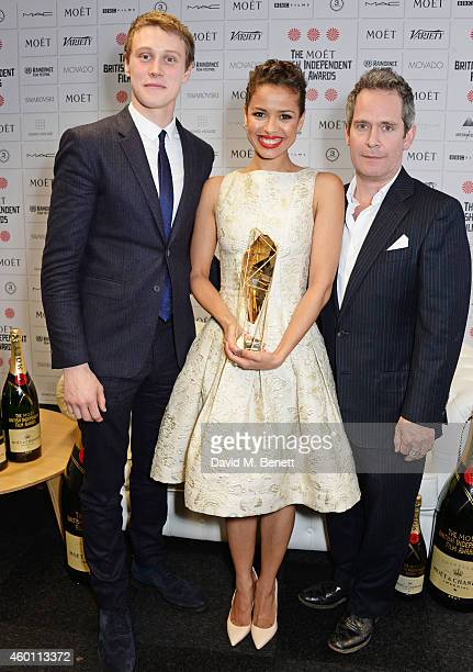 George Mackay Gugu MbathaRaw winner of the Best Actress award for 'Belle' and Tom Hollander pose at The Moet British Independent Film Awards 2014 at...
