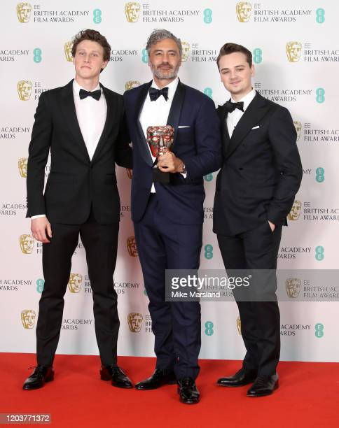 George MacKay Taika Waititi and DeanCharles Chapman pose in the Winners Room during the EE British Academy Film Awards 2020 at Royal Albert Hall on...