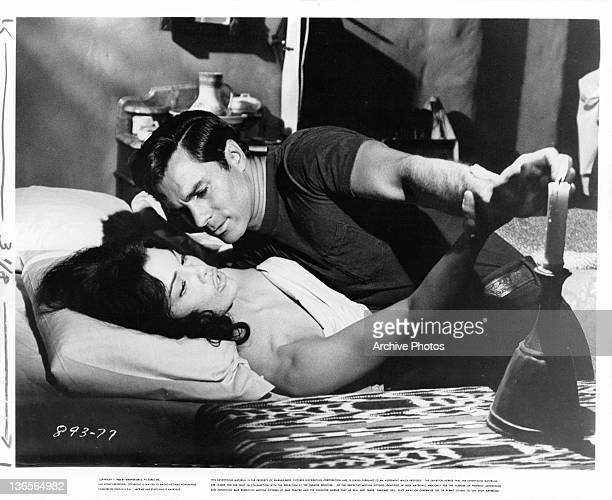 George Maharis laying on Katy Jurado in a scene from the film 'A Covenant With Death' 1967