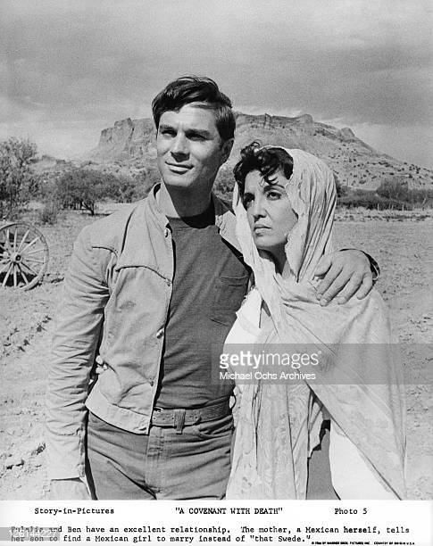 George Maharis puts his arm around his mother Katy Jurado in a scene from the film 'A Covenant With Death' 1966 Photo by Warner Brothers/Getty Images