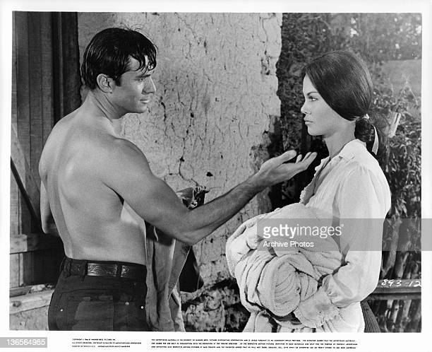 George Maharis reaches out to touch the chin Katy Jurado in a scene from the film 'A Covenant With Death' 1967