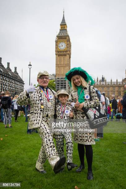 George Major Dylan Mirabita and Jessica Fulcher in Parliament Square London where onlookers have gathered as Big Ben's bongs ring out for the last...