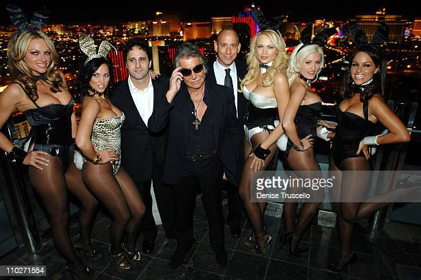George Maloof and Roberto Cavalli with Models Wearing Playboy Bunny Uniformes Designed By Roberto Cavalli