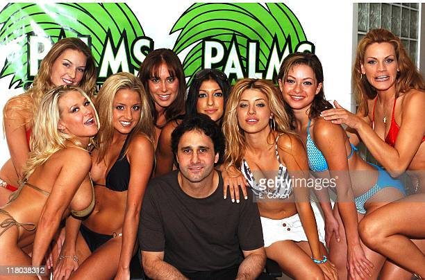 George Maloof owner of The Palms Casino and Resort is surrounded by contestants aspiring to be The Palms' Girl