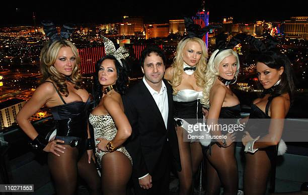 George Maloof with Models Wearing Playboy Bunny Uniformes Designed By Roberto Cavalli