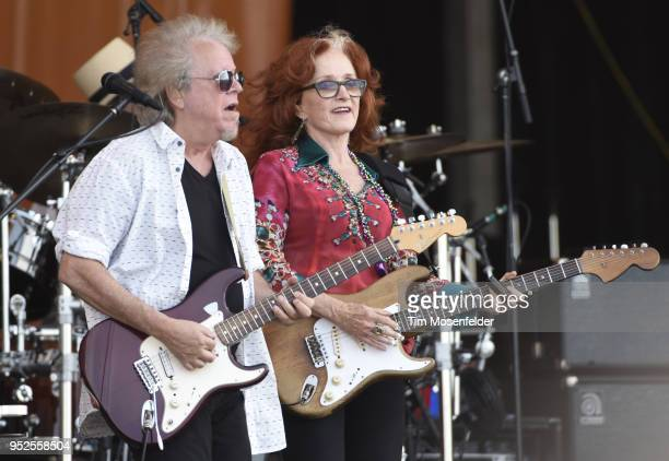 George Marinelli and Bonnie Raitt perform during the 2018 New Orleans Jazz Heritage Festival at Fair Grounds Race Course on April 28 2018 in New...