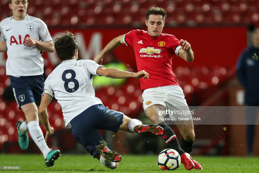 George Marsh of Tottenham Hotspur and Joe Riley of Manchester United during the Premier League 2 match between Manchester United and Tottenham Hotspur at Old Trafford on January 29, 2018 in Manchester, England.