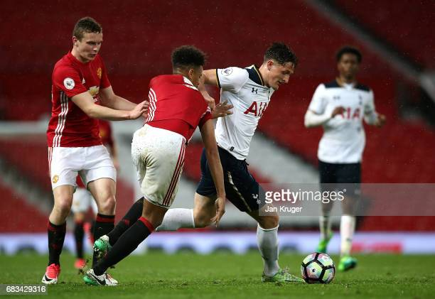 George Marsh of Tottenham Hotspur battles with Cameron BorthwickJackson of Manchester United during the Premier League 2 match between Manchester...