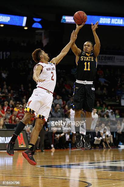George Marshall of the South Dakota State Jackrabbits puts up a shot over Melo Trimble of the Maryland Terrapins in the second half during the first...