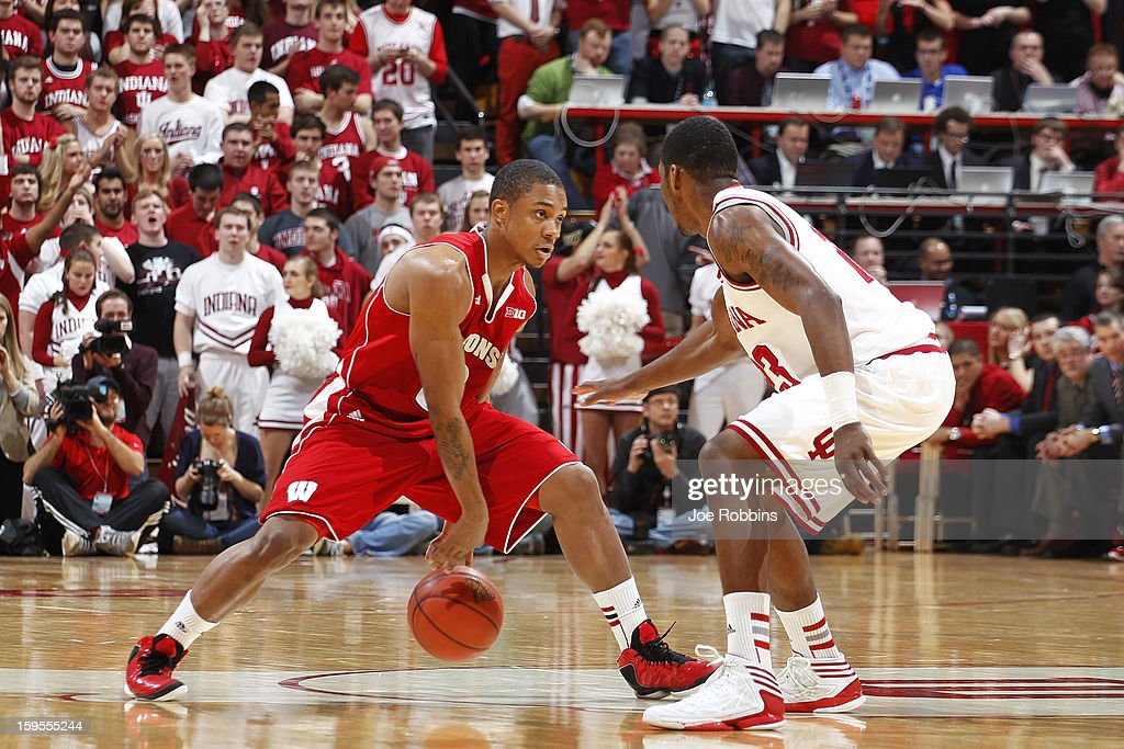 George Marshall #3 of the Wisconsin Badgers dribbles the ball up court against Remy Abell #23 of the Indiana Hoosiers during the game at Assembly Hall on January 15, 2013 in Bloomington, Indiana. Wisconsin defeated Indiana 64-59.