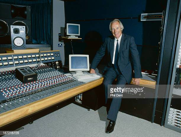 George martin poses by the mixing desk at Abbey Road Studios London 01 January 1987