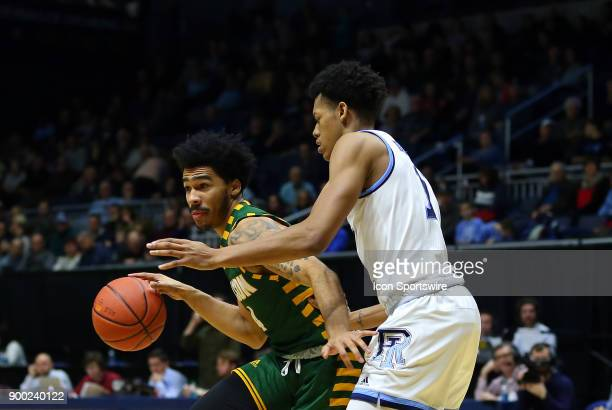George Mason Patriots guard Otis Livingston II and Rhode Island Rams guard Jeff Dowtin in action during a college basketball game between George...