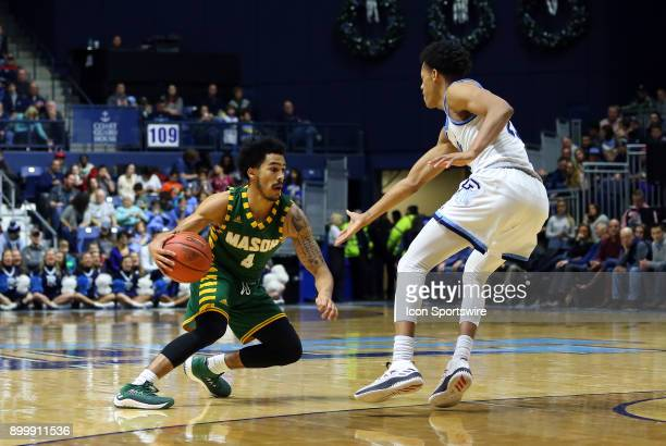 George Mason Patriots guard Otis Livingston II defended by Rhode Island Rams guard Jeff Dowtin during a college basketball game between George Mason...