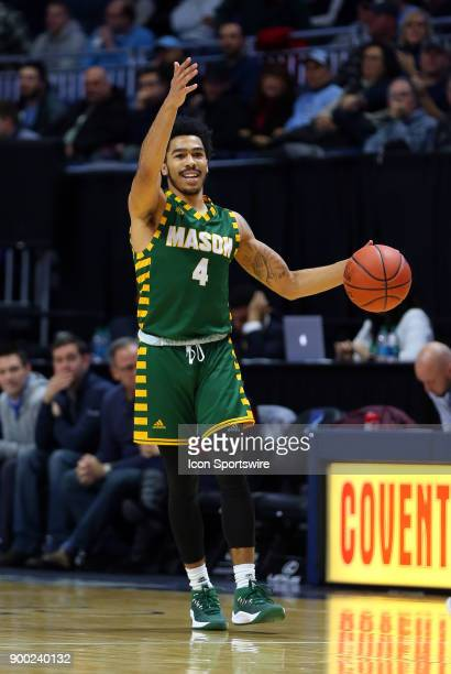 George Mason Patriots guard Otis Livingston II directs the offense during a college basketball game between George Mason Patriots and Rhode Island...