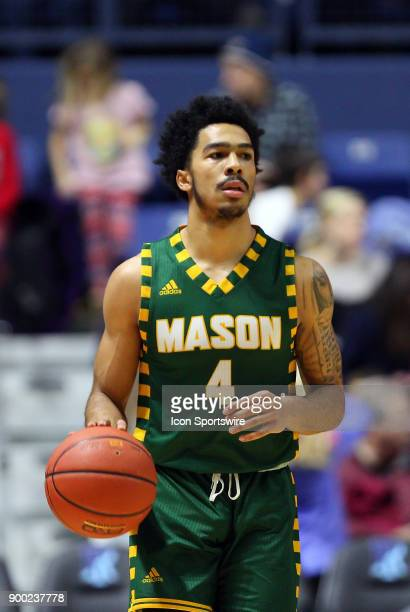 George Mason Patriots guard Otis Livingston II dribbles the ball up court during a college basketball game between George Mason Patriots and Rhode...