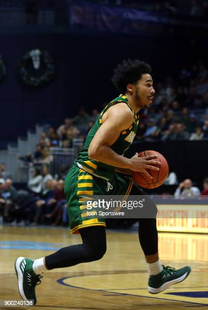 George Mason Patriots guard Otis Livingston II drives to the basket during a college basketball game between George Mason Patriots and Rhode Island...