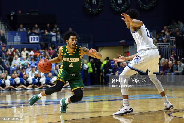 George Mason Patriots guard Otis Livingston II drives to the basket while defended by Rhode Island Rams guard Jeff Dowtin during a college basketball...