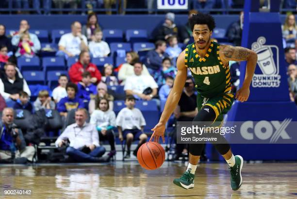 George Mason Patriots guard Otis Livingston II fast breaks during a college basketball game between George Mason Patriots and Rhode Island Rams on...