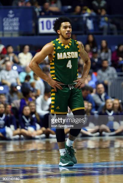 George Mason Patriots guard Otis Livingston II looks on during a college basketball game between George Mason Patriots and Rhode Island Rams on...
