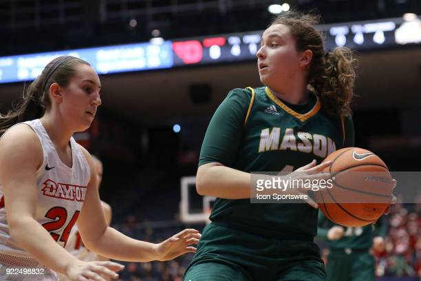 George Mason Patriots guard Sarah Kaminski looks for an open woman as Dayton Flyers guard Lauren Cannatelli defends in a game between the Dayton...