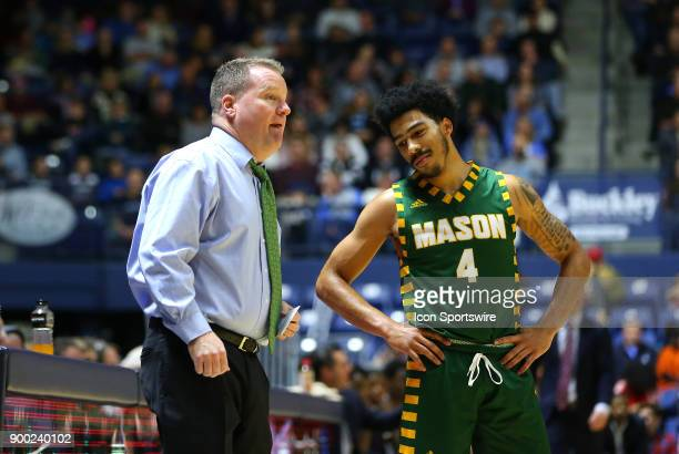 George Mason Patriots head coach Dave Paulsen speaks with George Mason Patriots guard Otis Livingston II during a college basketball game between...
