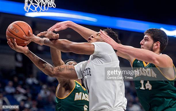 George Mason's Jaire Grayer left and Daniel Relvao conspire to block the shot of Penn State's Lamar Stevens at the Bryce Jordan Center in University...