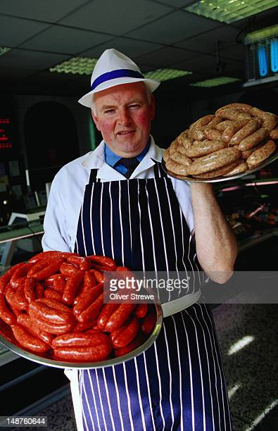 george mccartney with his sausages, beef and guinness and pork with chives. - guinness stock pictures, royalty-free photos & images