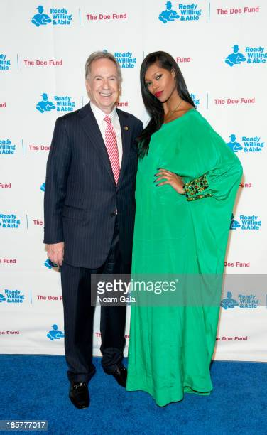 George McDonald and Model Jessica White attend the 2013 Doe Fund gala at Cipriani 42nd Street on October 24, 2013 in New York City.