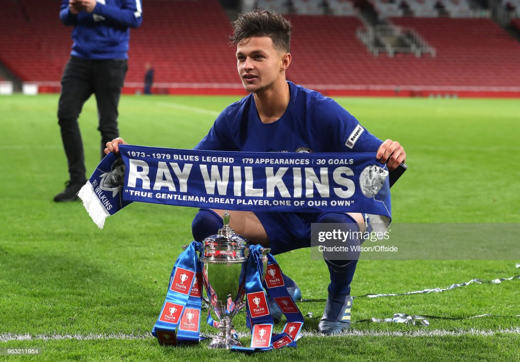 George McEachran of Chelsea poses with a Ray Wilkins scarf and the trophy during The Youth Cup Final, Second Leg between Arsenal and Chelsea at Emirates Stadium on April 30, 2018 in London, England.