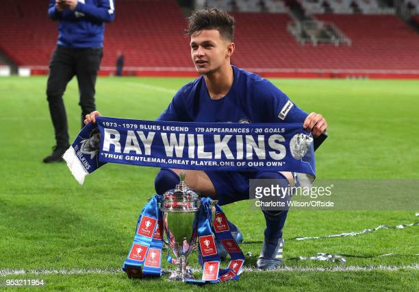 George McEachran of Chelsea poses with a Ray Wilkins scarf and the trophy during The Youth Cup Final Second Leg between Arsenal and Chelsea at...