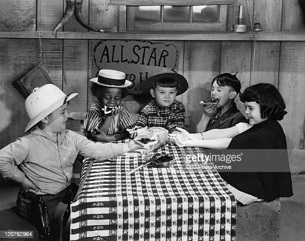 George McFarland as Spanky Billie Thomas as Buckwheat Eugene Lee as Porky Carl Switzer as Alfalfa and Darla Hood as Darla in one of the Our Gang...