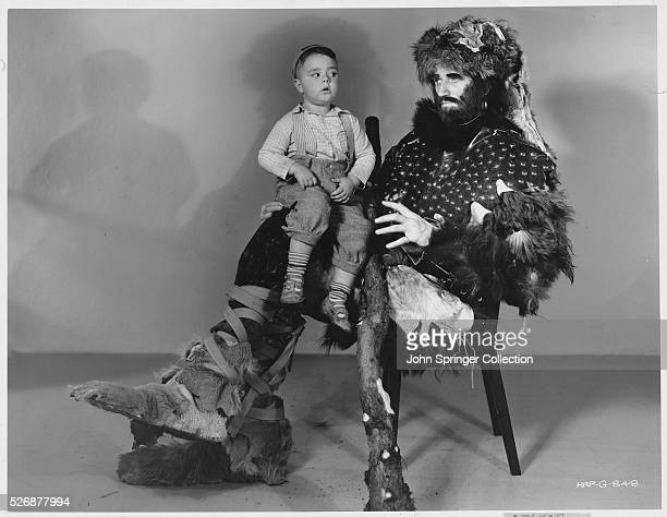 George McFarland known to millions as Spanky of the Little Rascals in Our Gang comedies sits on the lap of the 1934 Mama's Little Pirate costar Tex...