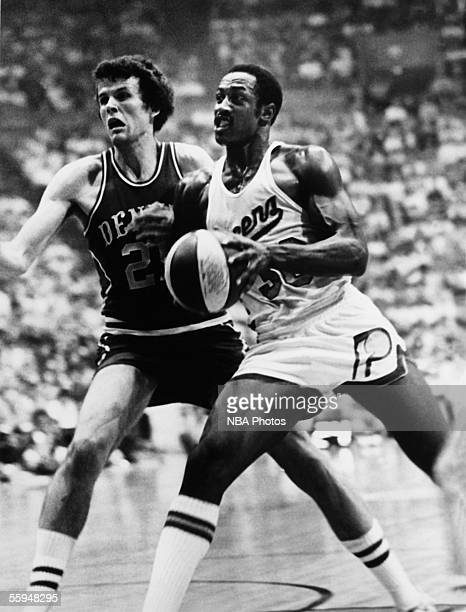 George McGinnis of the Indiana Pacers drives to the basket against the Denver Nuggets during an NBA game circa 1980 in Indianapolis Indiana NOTE TO...