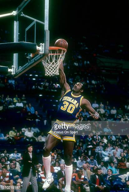 George McGinnis of the Indiana Pacers lays the ball up for two points against the Washington Bullets during an NBA basketball game circa 1980 at the...