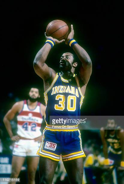 George McGinnis of the Indiana Pacers shoots a freethrow against the Washington Bullets during an NBA basketball game circa 1980 at the Baltimore...