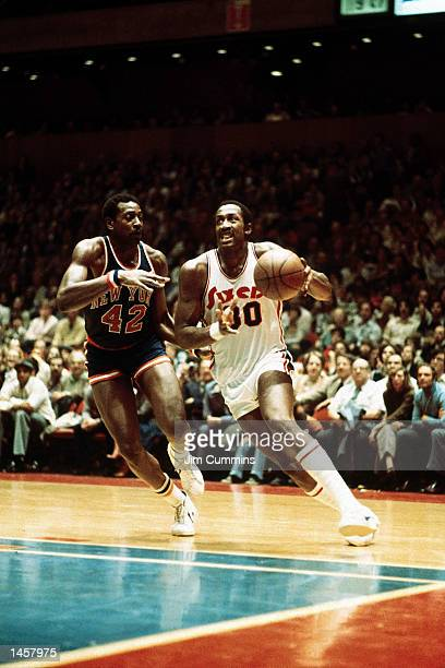 George McGinnis#30 of the Philadelphia 76ers drives to the basket in 1980 against the New York Knicks during an NBA game at The Spectrum in...