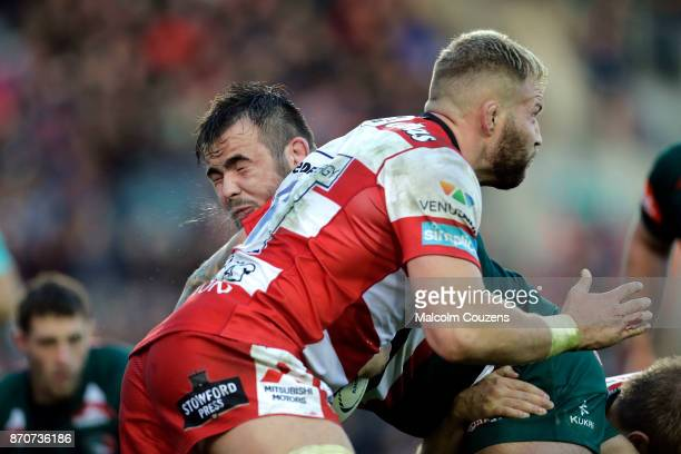 George McGuigan of Leicester Tigers collides with Ross Moriarty of Gloucester Rugby during the AngloWelsh Cup tie between Leicester Tigers and...